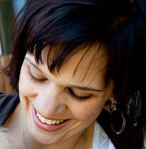 Deanna smiling, looking down